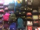 Поставка рюкзаков, пеналов, папок...
