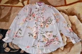 Нарядная блуза с цветочным принтом title=