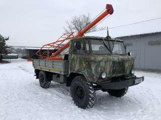 Ямобур БКМ-2,5 на базе Газ 66   предназначенный для бурения под опоры  title=