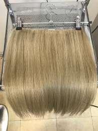 Волосы натуральные на заколках.