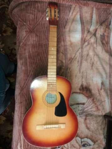 Гітара в чохлі почті нова