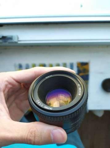 Объектив Nikon 50mm F 1:1.8D / (Nikkor 35 85 105)