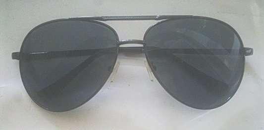 Солнцезащитные очки. Стекло серого цвета.